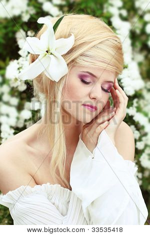 Portrait Of The Beautiful Romantic Woman With Flower. Sensual Touch