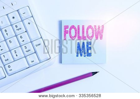 Handwriting text Follow Me. Concept meaning Inviting a demonstrating or group to obey your prefered leadership White pc keyboard with empty note paper and pencil above white background. poster