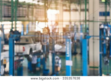 Blurred Background Of Technician Repairing The Car In Garage,mechanics Fixing In A Workshop Suspensi