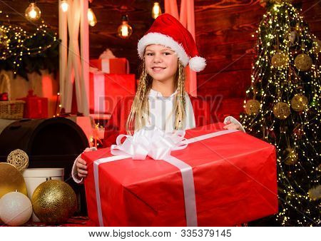 Child Having Fun On Christmas Eve. Giant Enormous Surprise. Winter Masquerade. Happiness And Joy. Gi