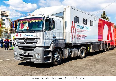 Samara, Russia - May 1, 2019: Mobile Blood Transfusion Station Vehicle At City Street. Text In Russi