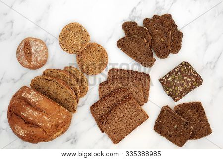 Low glycemic healthy bread variety for diabetics high in antioxidants, smart carbs & omega 3 fatty acids. Below 55 on the GI index. Top view on marble.