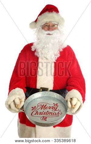 Santa Claus Christmas Donations. Santa holds an empty tray to collect money donations for the needy during the Christmas Holiday Season. Isolated on white. Room for text. Happy Holidays.