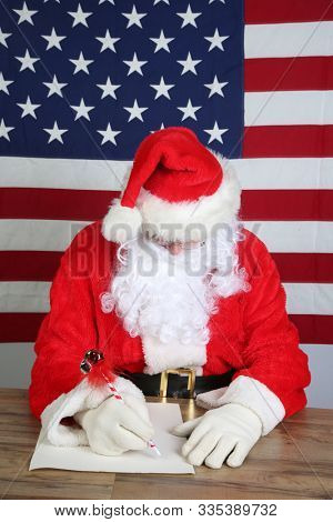 Santa Claus writes a letter. Santa sits at his desk at the North Pole and prepares to write his list of who has been naughty or nice for this years Christmas Gifts. Santa Sees you when your sleeping.