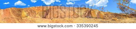 Banner Panorama Of Ochre Pits A Colorful Rock Formation Of Minerals Ochre On Banks Of A Sandy Creek