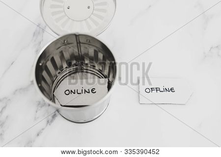 Social Media Obsession Conceptual Still-life, Garbage Bin With Online Sign In It And Offline Sign Ou
