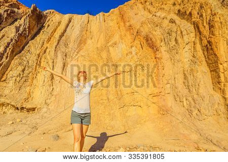 Carefree Tourist Woman Enjoying At Ochre Pits A Colorful Minerals Rock Formation In West Mcdonnell R