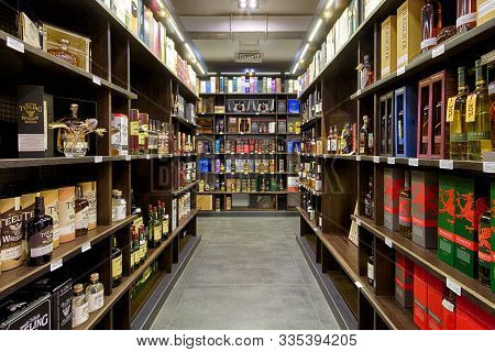 Moscow - Oct 6, 2019: Wine Shop Interior. Various Wine Bottles Sale On Wooden Shelves In Supermarket