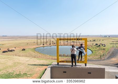 Alzu, South Africa - May 22, 2019: Tourists At The Photography Frame At Alzu Petruport Next To Road