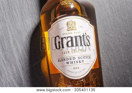 : Grants Rum Cask Finish Whisky On Stone Slate Background.  Grants Has Been Produced By William Gran