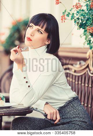 Woman Attractive Brunette Eat Gourmet Cake Cafe Terrace Background. Gastronomical Enjoyment. Gourmet