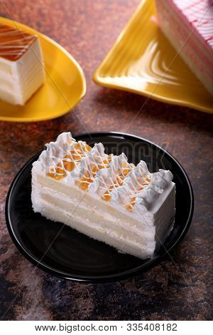 Fresh Dessert Pineapple Pastry Cake On Old Rustic Background