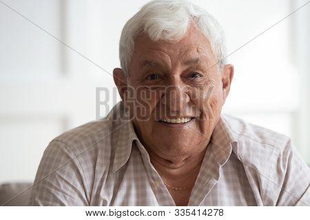 Headshot Closeup Portrait Of Happy Mature Grey-haired Man.