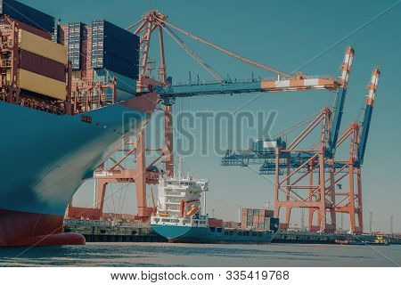Port Of Hamburg With Container Ship And Cranes