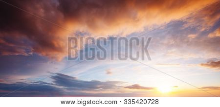 Perfect red clouds illuminated by the beams of the sun. Scenic image of textured sky. Photo of ecology concept. Natural wallpaper background. Epic sky in summer weather. Discover the beauty of earth.