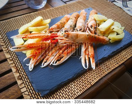 Scampi With Parsley And Fried Potatoes
