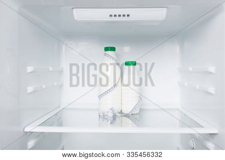 Concept Milk And Meter  For Measuring Body Size On The Background Of The Refrigerator, Milk Diet