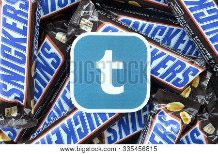 Tumblr Paper Logo On Many Snickers Chocolate Covered Wafer Bars In Brown Wrapping. Advertising Choco