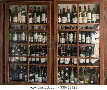 Castelnaud, Dordogne, France - September 7, 2018: A Collection Of Empty Wine Bottles In Castelnaud-l