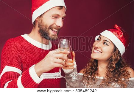 Happy Couple Celebrating Christmas Holidays - Young People Having Fun Drinking Champagne And Laughin