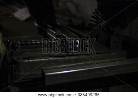 The Metal Lies On The Table. Metal Parts Are Prepared For Processing. The Atmosphere In An Advertisi