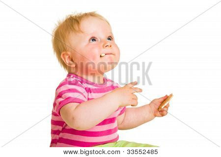 Infant Baby Learning To Eat A Biscuit