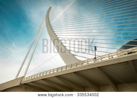 Beautiful view on the Modern Architecture building white Bridge in Valencia - under blue sky in sunny day.