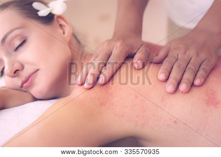Massaging, Scrubbing Spa Salt Scrub Beauty Treatment In Luxury Spa Room At Spa Salon. Body Scrub By