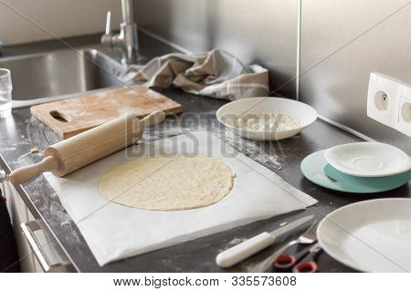 Preparation Of The Dough. The Rolling Pin With Flour On Kitchen Table With Ingredients. Rolling Doug