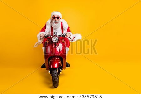 Full Length Photo Of Crazy Funky Santa Claus In Red Hat Drive Motorcycle Ride Fast Hurry To X-mas No