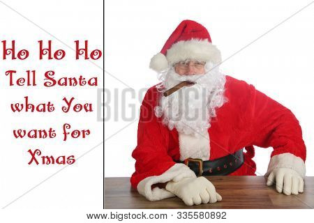 Santa Claus with a Cigar. Christmas card with the text Ho Ho Ho Tell Santa what you want for Xmas. Text is easily replaceable with your own. Happy Holidays and Merry Christmas to all.