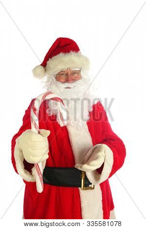 Santa Claus. Christmas Santa. Isolated on white. Room for text. Santa Claus holds a Giant Candy Cane. Peppermint Red and White Striped Candy Canes are popular world wide at Christmas.