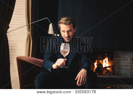portrait of a handsome man with a  drink