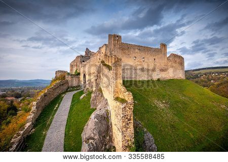 Medieval Castle Beckov In Autumn Landscape At Sunset, Slovakia, Europe.