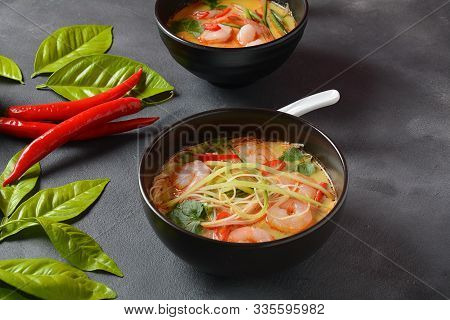 Laksa Soup - A Malaysian Coconut Curry Soup With Shrimps Over Rice Noodles Topped With Fresh Bean Sp