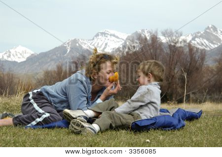Mother And Son Eating An Orange