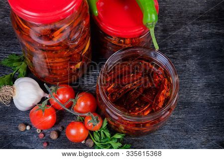 Sundried Red Tomatoes Preserved In Olive Oil In Different Small Closed Glass Jars Among Ingredients