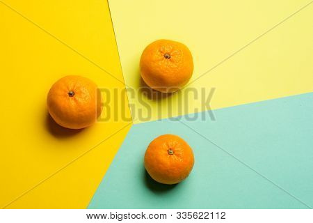 Creative Pattern Made Of Tangerines With Copy Space For Text On Bright Background. Flat Lay Minimal