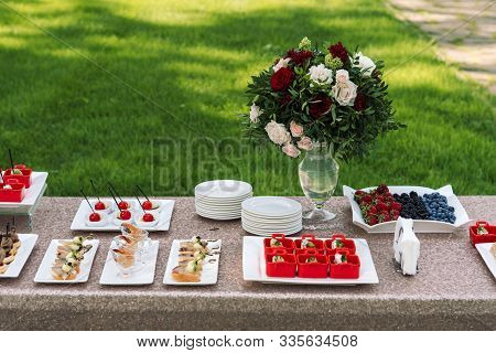Beautifully Decorated Catering Banquet Table With Different Food Snacks.