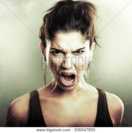 Face of angry mad furious young woman