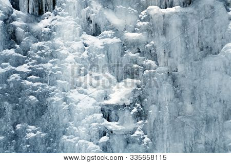 Background Mountain Waterfall Among Ice And Snow