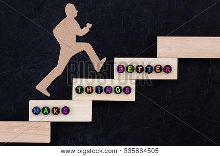 Make Things Better - Improvement Concept. Paper Man Climbing The Steps To Success In A Conceptual Im