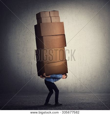 Bent Down Guy Carrying A Lot Of Big Heavy Boxes On His Back. Overloaded Of Daily Tasks, And Difficul
