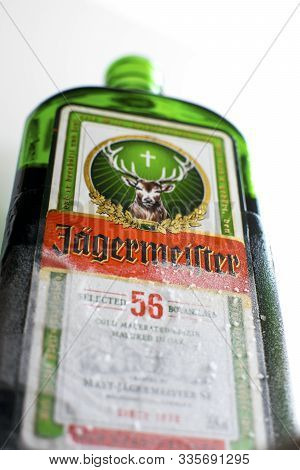 Green Bottle Of Jagermeister, Bottom View, Tasty Popular German Strong Liqueur Infused With Herbs. A