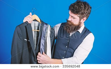 Shop Assistant Or Personal Stylist Service. Matching Necktie With Outfit. Man Bearded Hipster Hold N