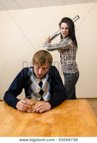 Domestic Violence: Wife Trying To Beat Her Husband With A Metal Rod