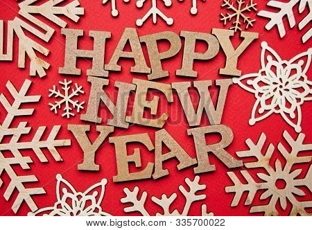 Happy New Year Vintage Style Background.hand Made Wooden Letters On Brown Backdrop Shot In Close Up.