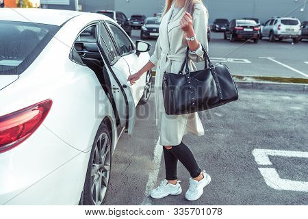 White Business Class Sedan, Woman Opens Door Of Taxi, Car On Call, Car Sharing. In Summer In City. W