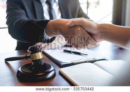 Handshake After Good Deal Negotiation Cooperation, Professional Male Lawyer Or Counselor And Client