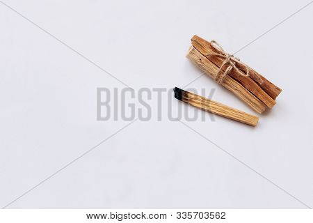 Palo Santo Sticks On A White Background. They Are Used In Aromatherapy And Religious Rites And Medit